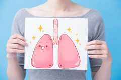 Woman take health lung billboard. On the blue background Stock Photo