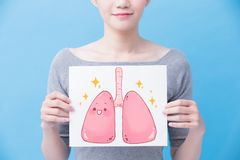 Woman take health lung billboard. On the blue background Royalty Free Stock Image
