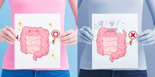 Woman take intestine billboard. On the blue background stock images