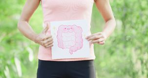 Woman take intestine board. Sport woman take intestine board with green background royalty free stock images