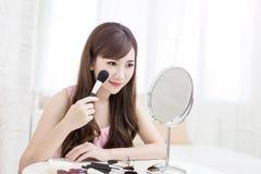 Woman take makeup brush Royalty Free Stock Images