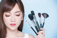 Woman take makeup brush Royalty Free Stock Photo