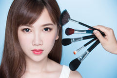 Woman take makeup brush Royalty Free Stock Photography