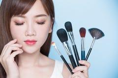 Woman take makeup brush Stock Photo