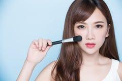 Woman take makeup brush Stock Image