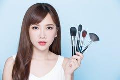 Woman take makeup brush Stock Photography