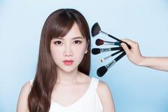 Woman take makeup brush Royalty Free Stock Image