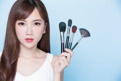 Woman take makeup brush Stock Images