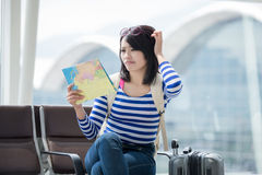 Woman take map and confuse Royalty Free Stock Image