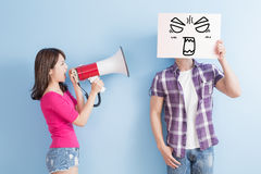 Woman take the microphone. Shout to men take angrily billboard isolated on blue background Stock Photos