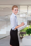 Woman take note in office Stock Photo