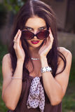 Woman take off sunglasses Royalty Free Stock Photos