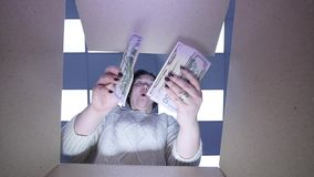 Woman take out of the box a lot of money and so Happy and Smiling.  stock video footage