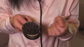 Woman take out hair from comb in hand.Hair loss concept