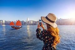Woman take a photo at Hong Kong stock photo