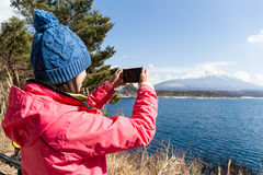 Woman take the photo on Mt. Fuji Royalty Free Stock Images