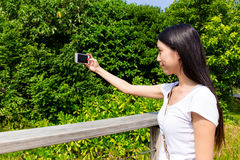 Woman take photo outdoor Royalty Free Stock Photography