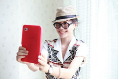 Woman take a photo by smart phone tablet Stock Photography