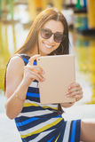 Woman take a photo with tablet Royalty Free Stock Image