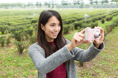Woman take a photo by using camera Royalty Free Stock Images