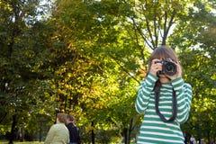 Woman take a photograph Stock Photo