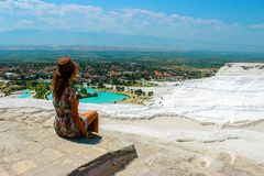 Woman take a picture of beautiful hill and village nature top view in Turkey royalty free stock photo