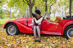 Woman take picture with car on background Royalty Free Stock Images
