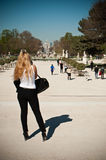Woman take a picture in Tuileries garden Royalty Free Stock Photos