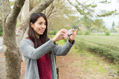 Woman take a picture by using camera Stock Photography