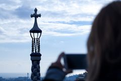 Woman take a pictures of parc guell royalty free stock photos