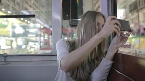 Woman Take Pictures from the Tram stock footage