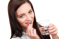 Woman take pill Stock Images
