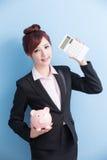 Woman take pink piggy bank Stock Photography