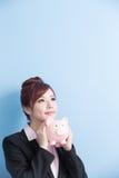 Woman take pink piggy bank Stock Photo