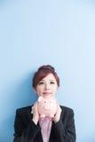 Woman take pink piggy bank Royalty Free Stock Photography