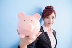 Woman take pink piggy bank Stock Photos