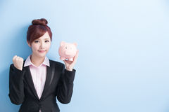 Woman take pink piggy bank Royalty Free Stock Image