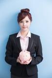 Woman take pink piggy bank Stock Images