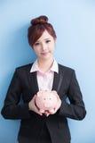 Woman take pink piggy bank Royalty Free Stock Photos