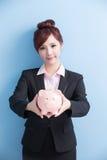 Woman take pink piggy bank Royalty Free Stock Images