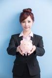 Woman take pink piggy bank Stock Image