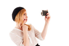 Woman take a self on retro camera Stock Photo
