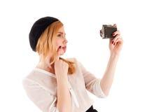 Woman take a self on retro camera Stock Photo