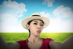 Woman take selfie on green grass field Stock Photo