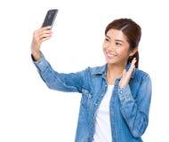 Woman take selfie Royalty Free Stock Photography
