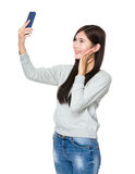 Woman take selfie Stock Image