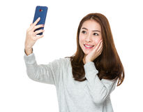 Woman take selfie Royalty Free Stock Image