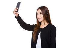 Woman take selfie with mobile phone Stock Photography