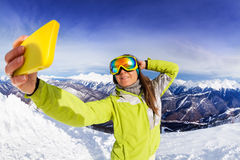 Woman take selfie over mountain and ski tracks Royalty Free Stock Photography