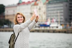 A woman take selfie on a street. In a European city Stock Photography